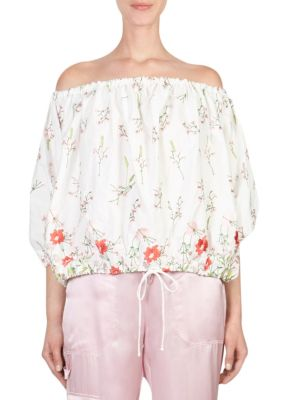 "Image of Off-the-shoulder top with floral embroidery. Off-the-shoulder. Three-quarter sleeves. Elasticized hem. Pullover style. About 21"" from shoulder to hem. Cotton/polyamide. Dry clean. Imported. Model shown is 5'10"" (177cm) and wearing US size Small."