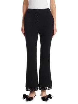 "Image of Button-front pants in flared silhouette. Belt loops. Front seam pockets. Front button closure. Rise, about 11"".Inseam, about 28"".Elastane/viscose. Dry clean. Imported. Model shown is 5'10"" (177cm) wearing a size 4."