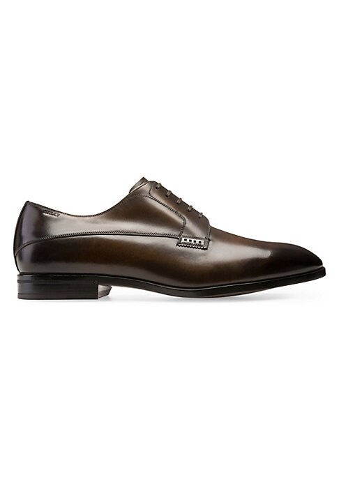 Image of Burnished almond toe derbys with smooth leather upper. Stacked heel. Leather upper. Almond toe. Lace-up vamp. Rubber sole. Imported.