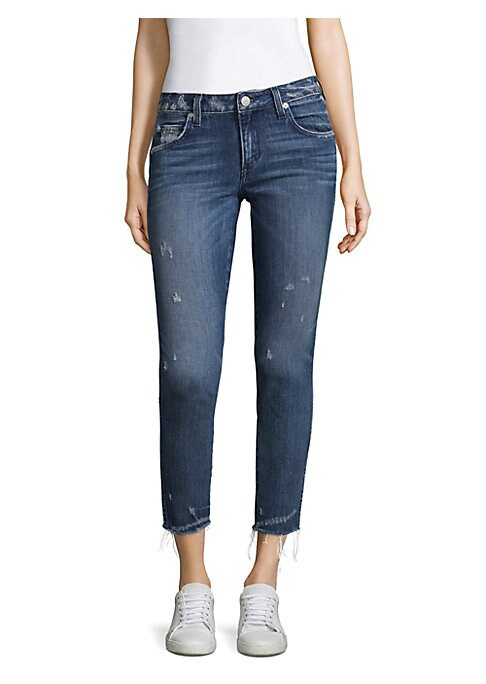 """Image of Cropped jeans in distressed design. Belt loops. Zip fly with button closure. Five-pocket style. Rise, about 11"""".Inseam, about 27"""".Cotton/elastane. Machine wash. Made in USA. Model shown is 5'10"""" (177cm) wearing US size 4."""