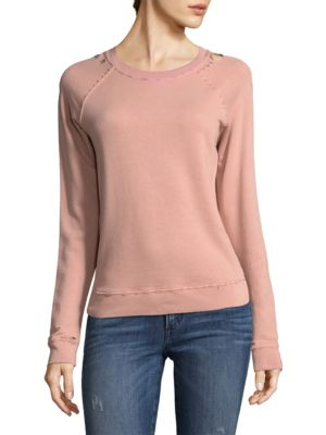 """Image of Raglan sleeve sweatshirt with distressed details. Roundneck. Long raglan sleeves. Pullover style. About 24"""" from shoulder to hem. Cotton. Machine wash. Made in USA. Model shown is 5'10"""" (177cm) and wearing US size Small."""