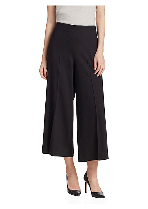 """Image of EXCLUSIVELY OURS. Wool-blend pants finished with cropped wide-leg silhouette. No-waistband style. Inseam, about 38"""".Wool/elastane. Professional dry clean. Imported. Model shown is 5'10"""" (177cm) wearing US size 4."""