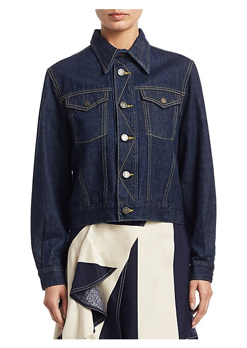 """Image of Denim trucker jacket with contrast stitching. Point collar. Long sleeves. Button front. Front buttoned flap pocket. About 25"""" from shoulder to hem. Cotton. Dry clean. Made in Italy. Model shown is 5'10"""" (177cm) wearing US size 4."""