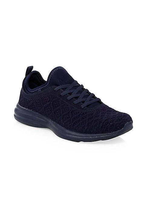 Image of Comfortable sneakers with metallic knit details. Polyester and thermofuse upper. Round toe. Lace-up vamp. Back pull tab. Polyester lining. EVA and rubber sole. Imported.