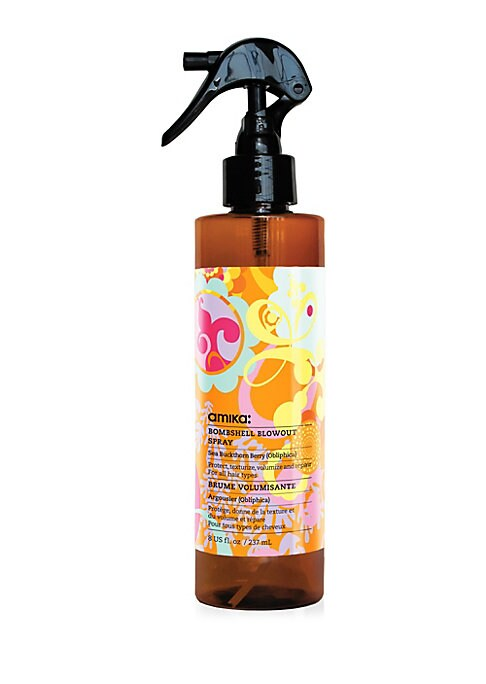 Image of Protect, Volumize, Texturize Amika Bombshell Blowout Spray delivers incredible volume, texture and body to hair for the ultimate blowout! Scents: warm vanilla, fresh citrus and spicy sweet clover. 8 oz. Made in USA.
