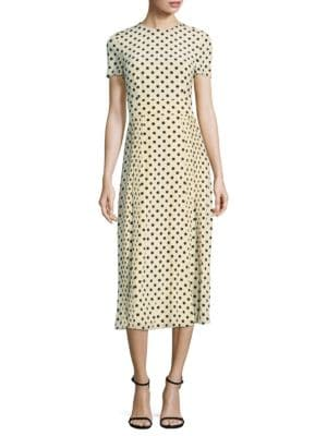 "Image of Pleated polka dot printed dress in luxe silk. Roundneck. Short sleeves. Concealed back zip closure. About 48"" from shoulder to hem. Silk. Dry clean. Imported. Model shown is 5'10"" (177cm) and wearing US size 4."