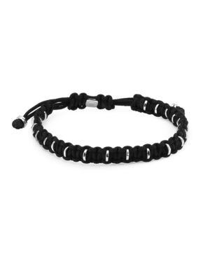 """Image of Easy to stack bracelet carefully wraps around silver discs. Silver. Nylon. Sliding knot clasp. Diameter, about 7"""".Made in UK."""