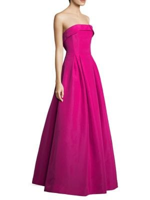 """Image of Strapless A-line gown crafted in luxurious silk. Fold-over neckline. Strapless. Concealed back zip closure. About 62"""" from shoulder to hem. Silk. Dry clean. Imported. Model shown is 5'10"""" (177cm) and wearing US size 4."""