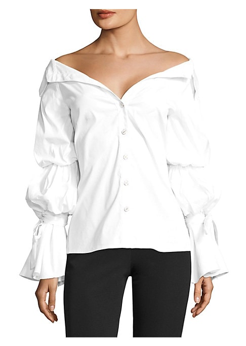 "Image of Dramatic puff sleeves update classic button-up. Off-the-shoulder point collar. Long elasticized puff sleeves. Tied bell cuffs. Button front. About 25"" from shoulder to hem. Cotton/polyamide/elastene. Dry clean. Made in USA. Model shown is 5'10"" (177cm) we"