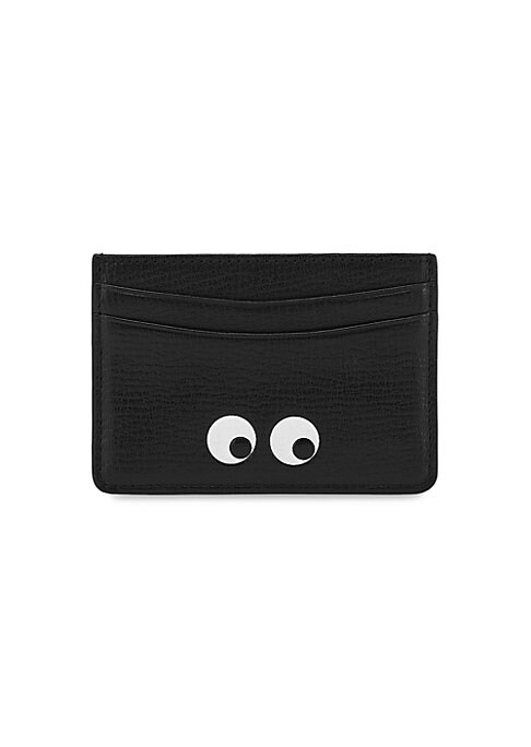 """Image of Cheeky eye graphic adorns sleek metallic card case. Two front card slots. Two back card slots.4""""W x 2.75""""H.Leather. Made in Italy."""