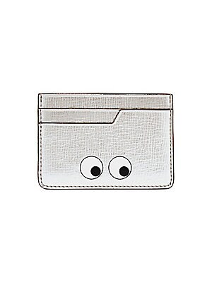 Image of Cheeky eye graphic adorns sleek metallic card case Two front card slots Two back card slots 4W x 2.75H Leather Made in Italy. Handbags - Advanced Designer Handba > Saks Fifth Avenue. Anya Hindmarch. Color: Silver.