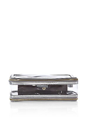 """Image of Clear cosmetic bag, with a chic boxy structure Dual zip around closures Goldtone hardware 8.85""""W X 4.75""""H X 3.5""""D Plastic Trim: leather Imported. Handbags - Advanced Designer Handba. Anya Hindmarch. Color: Silver."""