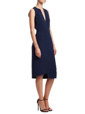 "Image of Belted wrap dress in asymmetric design.V-neck. Sleeveless. Belted waist. Concealed back zip closure. About 45"" from shoulder to hem. Triacetate/polyester. Dry clean. Made in Italy. Model shown is 5'10"" (177cm) and wearing US size 4."