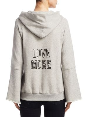 "Image of Bell sleeve sweatshirt with love more graphic. Attached drawstring hood. Long bell sleeves. Front kangaroo pocket. Pullover style. About 26"" from shoulder to hem. Cotton. Machine wash. Imported. Model shown is 5'10"" (177cm) and wearing US size Small."