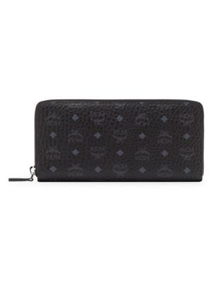 """Image of .On-trend leather wallet with allover logo print. .Zip-around closure. .One interior zip pocket. .Two interior compartments. .Six interior credit card slots. .7.25""""W x 3.6""""H x 0.75""""D. .Leather. .Imported."""
