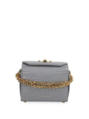 "Image of Crocodile-embossed crossbody bag with goldtone chain strap. Removable, adjustable crossbody strap, 10"" drop. Turn lock closure. Goldtone hardware. Three interior compartments. One interior zip pocket. One interior card slot.7.5""W x 7""H x 3""D.Leather. Made"
