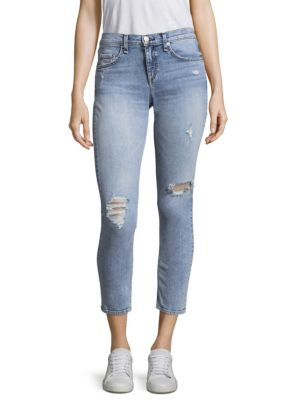 "Image of Distressed skinny jeans. Five-pocket style. Zip fly with button closure. Rise, about 8.5"".Leg circumference, about 10"".Inseam, about 27"".Cotton/spandex. Machine wash. Made in USA. Model shown is 5'10"" (177cm) wearing US size 4."