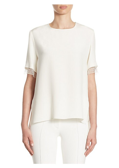 """Image of Luxe silk tee accented with lace trim. Roundneck. Short sleeves. Button closure at back keyhole. About 25"""" from shoulder to hem. Silk. Dry clean. Made in USA. Model shown is 5'10"""" (177cm) wearing US size 4."""