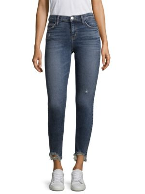"Image of Distressed skinny jeans. Five-pocket style. Zip fly with button closure. Distressed hem. Rise, about 8.5"".Leg circumference, about 10.5"".Inseam, about 27.5"".Cotton/elastane/polyester. Machine wash. Imported. Model shown is 5'10"" (177cm) wearing a US size"