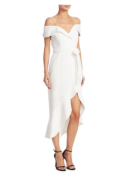 "Image of Asymmetric ruffle silhouettedetailed dress. Off-the-shoulder neckline. Short sleeves. Self-tie at waist. Asymmetrical hem. About 47"" from shoulder to hem. Polyester. Dry clean. Imported. Model shown is 5'10"" (177cm) wearing US size 4."