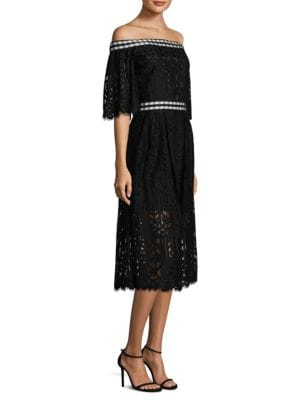 "Image of Chic midi dress in embroidered mesh lace construction. Off-the-shoulder neckline. Short sleeves. Concealed back zip. Lined. About 41"" from shoulder to hem. Nylon/cotton. Dry clean. Imported. Model shown is 5'10"" (177cm) wearing a size 4."