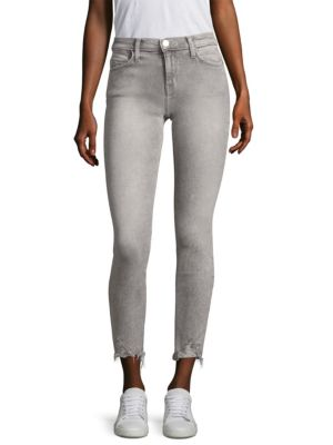 "Image of Acid wash skinny jeans with distressed details. Five-pocket style. Zip fly with button closure. Rise, about 8.5"".Leg circumference, about 10.5"".Inseam, about 27.5"".Cotton/polyester/elastane. Machine wash. Imported. Model shown is 5'10"" (177cm) wearing a U"
