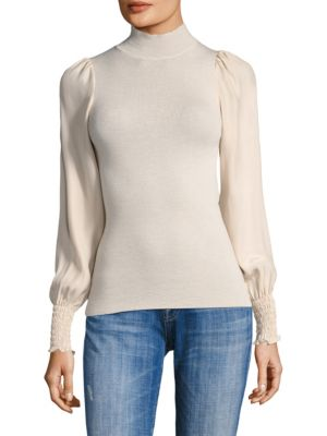"Image of Top with shirred detailing. Mockneck. Long sleeves. Pullover style. About 25"" from shoulder to hem. Wool. Contrast: Silk. Hand wash. Imported. Model shown is 5'10"" (177cm) and wearing US size Small."