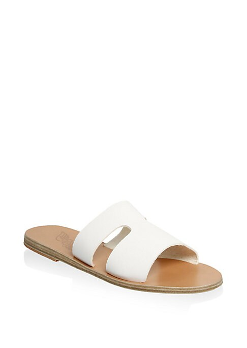 Image of Cut-out slides with crafted from smooth leather. Leather upper. Leather sole. Made in Greece.