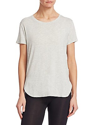 """Image of Casual tee with curved hem Crewneck Short sleeves About 25"""" from shoulder to hem Viscose/elastane Machine wash Imported Model shown is 5'10"""" (177cm) wearing a size Small. Private Brand - Sfa Knitwear. Majestic Filatures. Color: White. Size: 2 (Small)."""