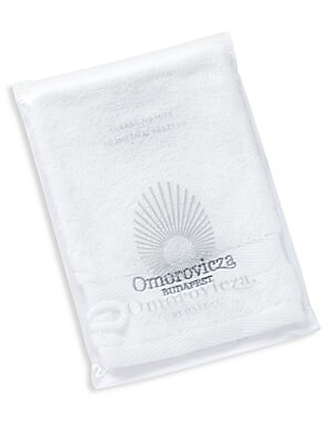 Image of Made from pure cotton, this gentle cleansing mitt removes cleansers and masks to leave skin soft and clean. Non-Comedogenic. Imported. Cosmetics - Treatment Brand. Omorovicza.