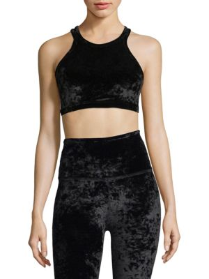 "Image of Crushed velvet sports bra with criss cross straps. Roundneck. Sleeveless. Pullover style. About 15"" from shoulder to hem. Polyester/spandex. Machine wash. Imported. Model shown is 5'10"" (177cm) and wearing US size Small."