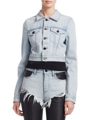 """Image of Archetypal denim jacket with a shrunken fit. Spread collar. Long sleeves. Button cuffs. Button front. Chest button flap patch pockets. Back button tabs at waist. About 24"""" from shoulder to hem. Cotton. Dry clean. Imported. Model shown is 5'10"""" (177cm) wea"""