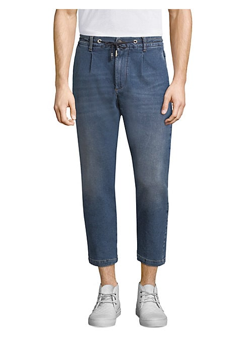 """Image of Stylish cropped denim with jogger-like details. Drawstring waist with belt loops. Zip fly with button closure. Waist slant pockets. Back button flap pockets. Tapered leg. Rise, about 11"""".Inseam, about 27"""".Cotton/elastane. Machine wash. Made in Italy."""