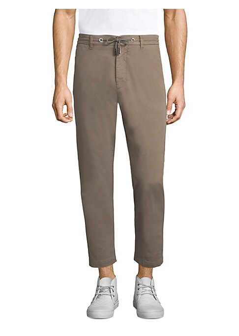 """Image of Jogger details add casual cool to canvas pants. Belt loops. Drawstring waist. Zip fly with button closure. Waist slant pockets. Back button flap pockets. Tapered leg. Rise, about 11"""".Inseam, about 29"""".Cotton/elastane. Machine wash. Made in Italy."""