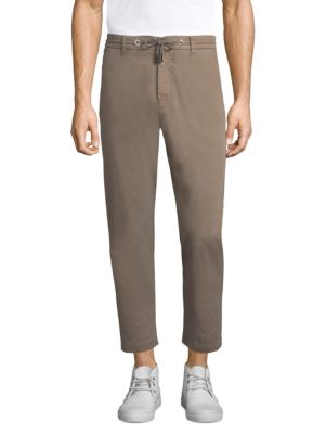 """Image of Jogger details add casual cool to canvas pants. Drawstring waist with belt loops. Zip fly with button closure. Waist slant pockets. Back button flap pockets. Tapered leg. Rise, about 11"""".Inseam, about 29"""".Cotton/elastane. Machine wash. Made in Italy."""