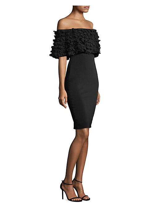 """Image of Classic petal dress with ruffled trims. Off-the-shoulder neckline. Short ruffle sleeves. Concealed back zip. About 34"""" from shoulder to hem. Lined. Polyester/spandex. Dry clean. Imported. Model shown is 5'10"""" (177cm) and wearing US size 4."""