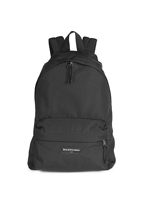 "Image of .Classic backpack with front logo detail. Top handle. Adjustable backpack straps. Zip-around closure. Exterior front zip pocket. Interior zip pocket. Interior open pocket. Lined.14.5"" W x 19.5"" H x 8"" D.Nylon/polyester. Made in Italy."