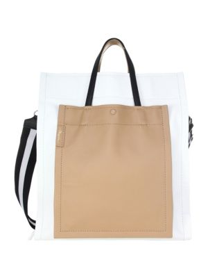 "Image of Accordion tote bag in luxe colorblock leather. Double top handle. Removable shoulder strap. Magnetic snap-tab closure. Outside slip pocket. 16""H x 14.5""W x 9""D.Leather. Imported."