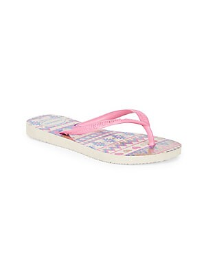 Image of Slim silhouette in a glitter cherry print completes these PVC flip flops Slip-on style PVC upper Rubber sole Imported. Children's Wear - Children's Shoes > Saks Fifth Avenue. Havaianas. Color: Beige Pink. Size: 25-26/ 10 US (Toddler).