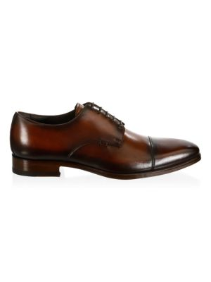 Image of Enhance your casual ensemble with these leather derbys. Leather upper. Cap toe. Lace-up vamp. Leather lining and sole. Made in Italy.