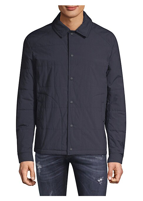 """Image of Comfortable quilted jacket with signature logo patch detail. Spread collar. Long sleeves. Front snap closure. Side snap-welt pockets. Lined. About 25"""" from shoulder to hem. Polyamide. Hand wash. Imported."""