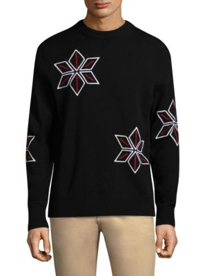 """Image of Soft and cozy merino sweater with intarsia details. Crewneck. Long sleeves. Rib-knit at neck, cuffs, and hem. About 28"""" from shoulder to hem. Merino wool. Dry clean. Imported."""