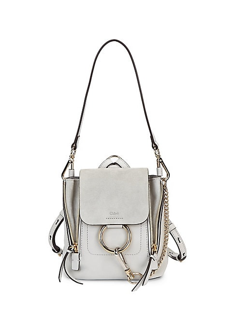"Image of . Leather mixed-media backpack with signature hardware. . Removable top handle. . Adjustable backpack straps. . Magnetic snap-flap closure with clip-lock ring. . Goldtone hardware. . Fully lined. . 8.75""W x 10""H x 6.5""D. . Leather. . Made in Italy. ."