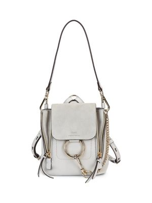 """Image of . Leather mixed-media backpack with signature hardware. . Removable top handle. . Adjustable backpack straps. . Magnetic snap-flap closure with clip-lock ring. . Goldtone hardware. . Fully lined. . 8.75""""W x 10""""H x 6.5""""D. . Leather. . Made in Italy. ."""