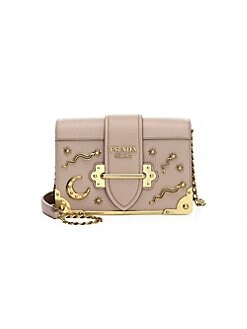 f4d539d5a079 Product image. QUICK VIEW. Prada. Cahier Studded Leather Crossbody Bag