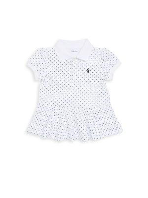Image of A playful peplum hem and the season's graphic polka dots put a fresh spin on Ralph Lauren's timeless Polo shirt. Ribbed Polo collar. Puffed short sleeves with ribbed armbands. Three-button placket. Signature embroidered pony at the left chest. Peplum hem.