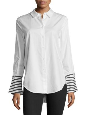 "Image of Classic button down shirt with statement striped back. Spread collar. Front button closure. Long sleeve with oversize button cuff. Contrast pattern at cuff and back. Back yoke seam. Shirt tail hem. About 29"" from shoulder to hem. Cotton. Dry clean. Import"