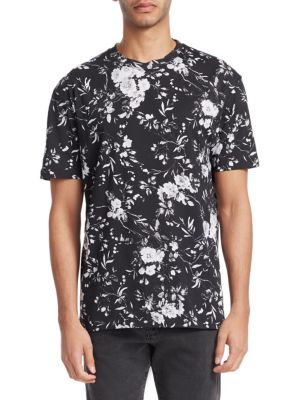 "Image of Casual cotton tee with allover floral print. Crewneck. Short sleeves. About 27"" from shoulder to hem. Cotton. Machine wash. Imported."