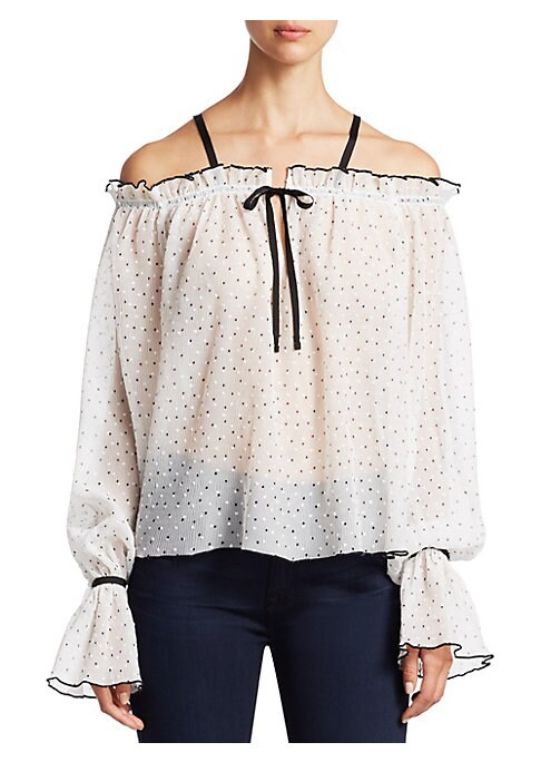 "Image of Miniature dots add a whimsical pattern to this shoulder-baring top. Off-the-shoulder neckline. Long sleeves. Ruffled cuffs. Pullover style. About 21"" from shoulder to hem. Polyester. Dry clean. Imported. Model shown is 5'10"" (177cm) wearing US size 4."