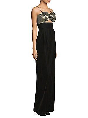 """Image of Alluring velvet jumpsuit in bow metallic detail Sweetheart neckline Spaghetti straps Concealed back zip Cutout waist Wide-leg silhouette Inseam, about 35 Polyester/cotton/metallic Dry clean Made in USA Model shown is 5'10"""" (177cm) wearing size Small. Cont"""